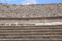 The amphitheatre is used today for concerts. The top section is unrestored.